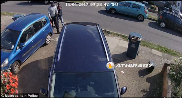 The two men approach the house inStanmore, north-west London, where a man in his 40s was shot by a stun gun
