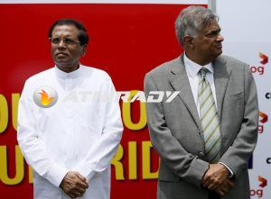 Sri Lanka's Prime Minister Ranil Wickremesinghe (R) and President Maithripala Sirisena stand next to each other during cricketer Kumar Sangakkara's retirement ceremony, August 24, 2015. REUTERS/Dinuka Liyanawatte/Files