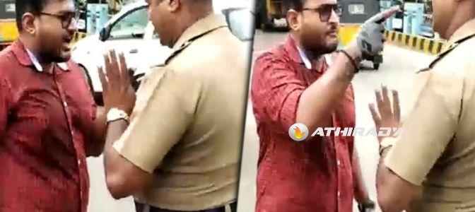 போலீஸுடன் சண்டைக்கு போன ஓவர் ஸ்பீட் இளைஞர்! (வீடியோ)